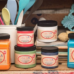 Several jars of Dixie Bell paint in various colors