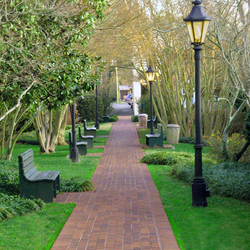 Image of Haydens Lane a brick path with bench and landscaping