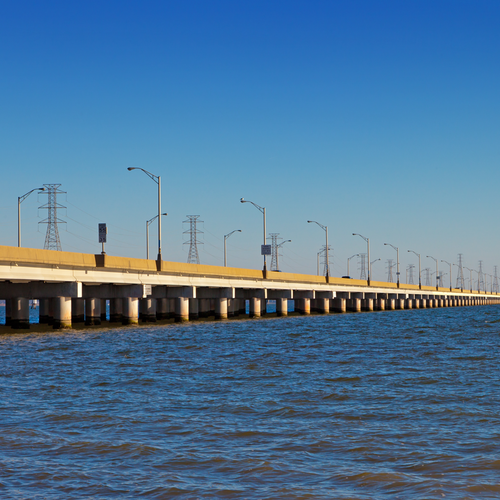 Image from the water of a span of the James River Bridge connecting Isle of Wight and Newport News