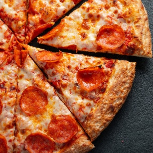 Corner of pizza with slices cut out